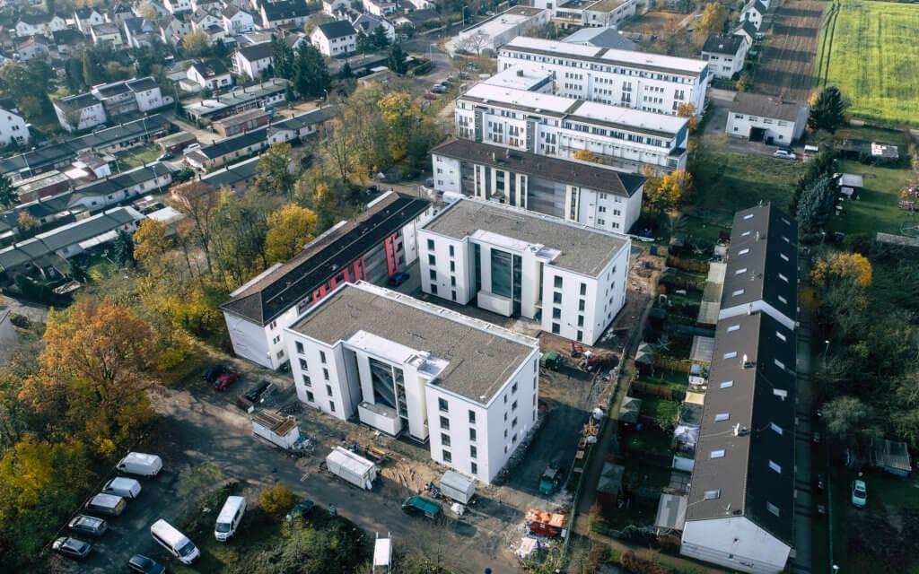 Dreidimensionale und visuelle Dokumentation per Drohne in Darmstadt der Quartiersmodernisierung Rodgaustraße für die bauverein AG