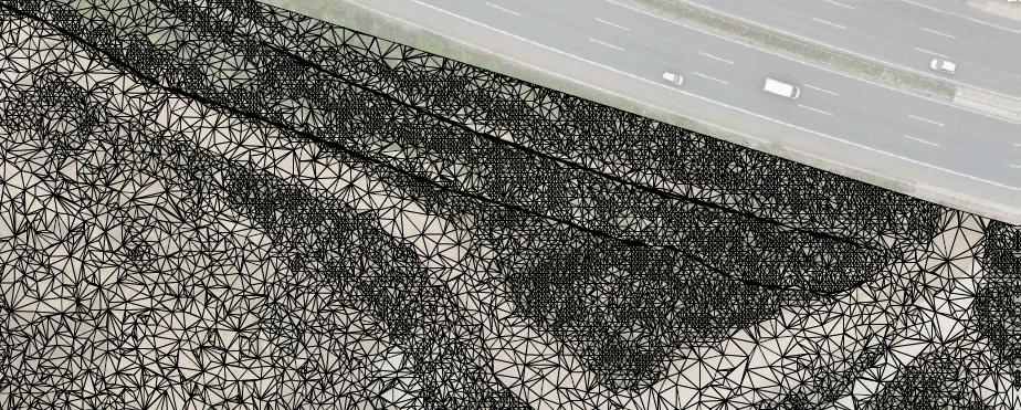Dreiecksvermaschung-mit-Orthofoto-Volumenberechnung-Ergebnis-DGM-Erstellung-eines-Steinbruchs-aus-Drohnendaten
