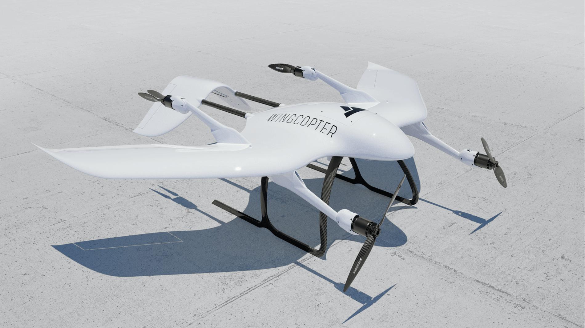 Logxon-wingcopter-vermessung-vtol-drohne-laser-survey-fixed-wing-abflugbereit-weiß-motoren-propeller-wing-copter